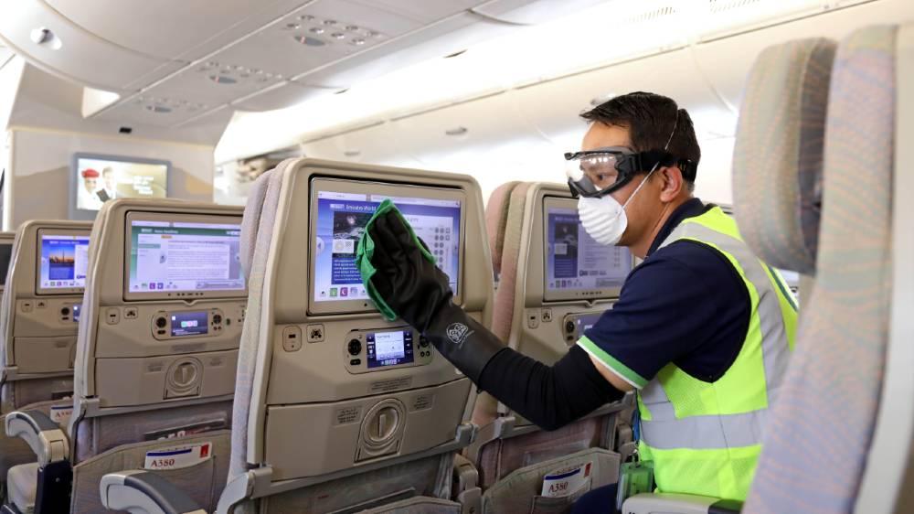 Global airlines slash flights as travel restrictions multiply